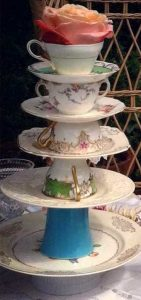 tall cake display made from teacups and plates